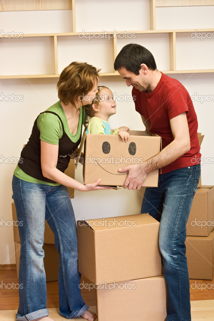 Happy family with a kid moving into a new home concept — Stock Photo #6430478