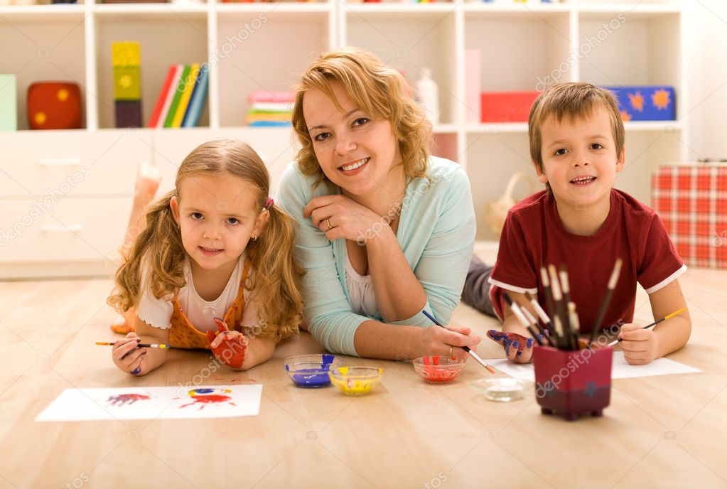 Woman and kids having some heavy artwork fun — Stock Photo #6430585