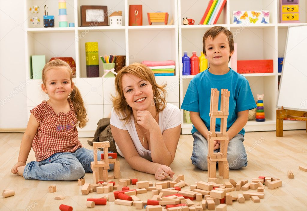 Mother spending time with her kids, playing on the floor — Stock Photo #6430590