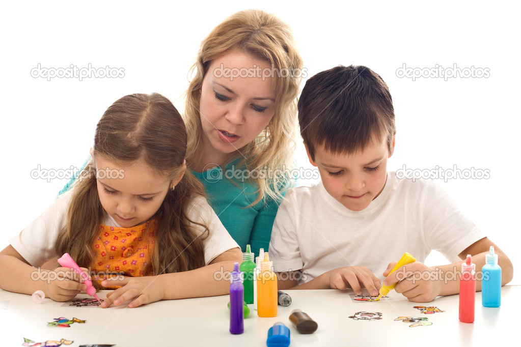 Kids busy painting with lots of colors, supervised by their mother - isolated — Stock Photo #6430641