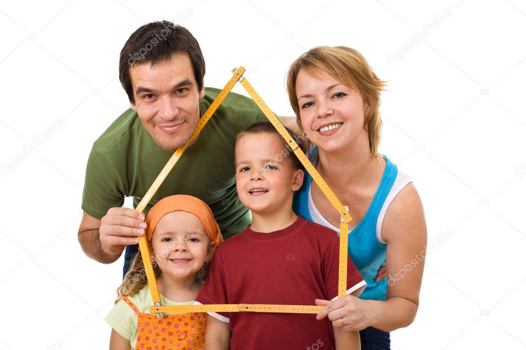 Happy family with their kids planning to buy a new home - isolated — Stock Photo #6430723