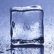 Backlit ice cube, with droplets — Stock Photo
