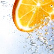 Stock Photo: Slice of orange in bubbly drink