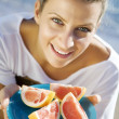 Woman with pink grapefruit — Stock Photo