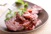 Beef steak in redwine — Stock Photo