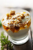 Yogurt with honey and muesli — Stock Photo