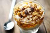 Yogurt with honey and muesli — Stock Photo