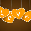 Hanging hearts with love signature. — Stock Vector
