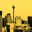 Silhouette of skyscrapers with yellow background. Vector - Stok Vektör
