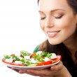 Portrait of happy smiling woman with plate of salad, isolated on — Stock Photo