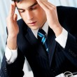 Thinking, tired or ill with headache businessman at office - Foto Stock
