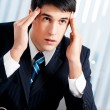 Thinking, tired or ill with headache businessman at office — Stockfoto