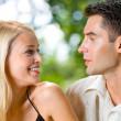 Portrait of young happy attractive couple together, outdoors — Stock Photo #6304809