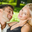 Young happy amorous couple together, outdoors - Stock Photo