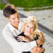 Young happy embracing couple, outdoors — Stock Photo