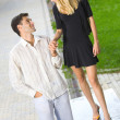 Stock Photo: Young happy amorous couple together, outdoors