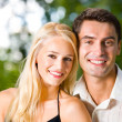 Portrait of young happy attractive couple together, outdoors — 图库照片