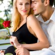 Happy pregnant woman with rose and her husband, outdoors - Foto de Stock