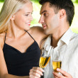 Royalty-Free Stock Photo: Young happy couple celebrating with champagne, outdoors