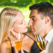 Stock Photo: Young happy couple celebrating with champagne, outdoors