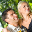 Young happy couple celebrating with champagne, outdoors — Stock Photo