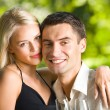 Young couple celebrating with champagne together, outdoors — Stock Photo #6305128