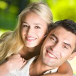 Young happy smiling attractive couple together outdoors — Foto de Stock