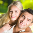 Young happy smiling attractive couple together outdoors — Stock Photo #6305214