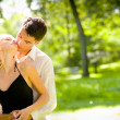 Portrait of young happy attractive embracing couple, outdoors — Stock fotografie