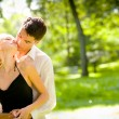 Foto de Stock  : Portrait of young happy attractive embracing couple, outdoors