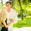 Portrait of young happy attractive embracing couple, outdoors — Stock Photo #6305297