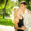 Portrait of young happy attractive embracing couple, outdoors — Stock Photo #6305301