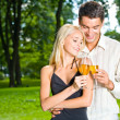 Young happy couple celebrating with champagne, outdoors — Stock Photo #6305324