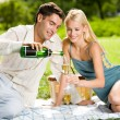 Happy successful attractive couple celebrating together with cha — Stock Photo