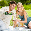 Happy successful attractive couple celebrating together with cha - Stock Photo