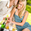 Young couple celebrating with champagne together, at picnic — Stock Photo #6305435
