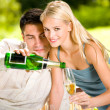 Young couple celebrating with champagne together, outdoors — Stock Photo #6305448