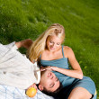 Young happy attractive amorous couple at picnic — Stock fotografie
