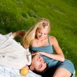 Young happy attractive amorous couple at picnic — Stock Photo