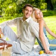 Young happy couple with apples at picnic, outdoors — Foto de Stock