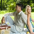 Young happy amorous couple together at picnic, outdoors — Stock Photo #6305500
