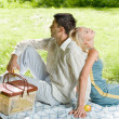 Young happy amorous couple together at picnic, outdoors — Stock Photo #6305502