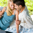 Young happy smiling couple with laptop at picnic — Stock Photo #6305512