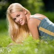 Young attractive blond woman with laptop, outdoors — Стоковое фото #6305543