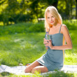 Young attractive woman with bottle of water outdoors — Stock fotografie
