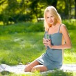 Young attractive woman with bottle of water outdoors — Stok fotoğraf