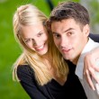 Young happy attractive embracing couple, outdoors — Stock Photo #6305629