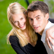 Young happy attractive embracing couple, outdoors — Stock Photo