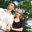 Young happy attractive couple walking outdoors together - Стоковая фотография