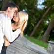 Royalty-Free Stock Photo: Young happy embracing couple kissing outdoors